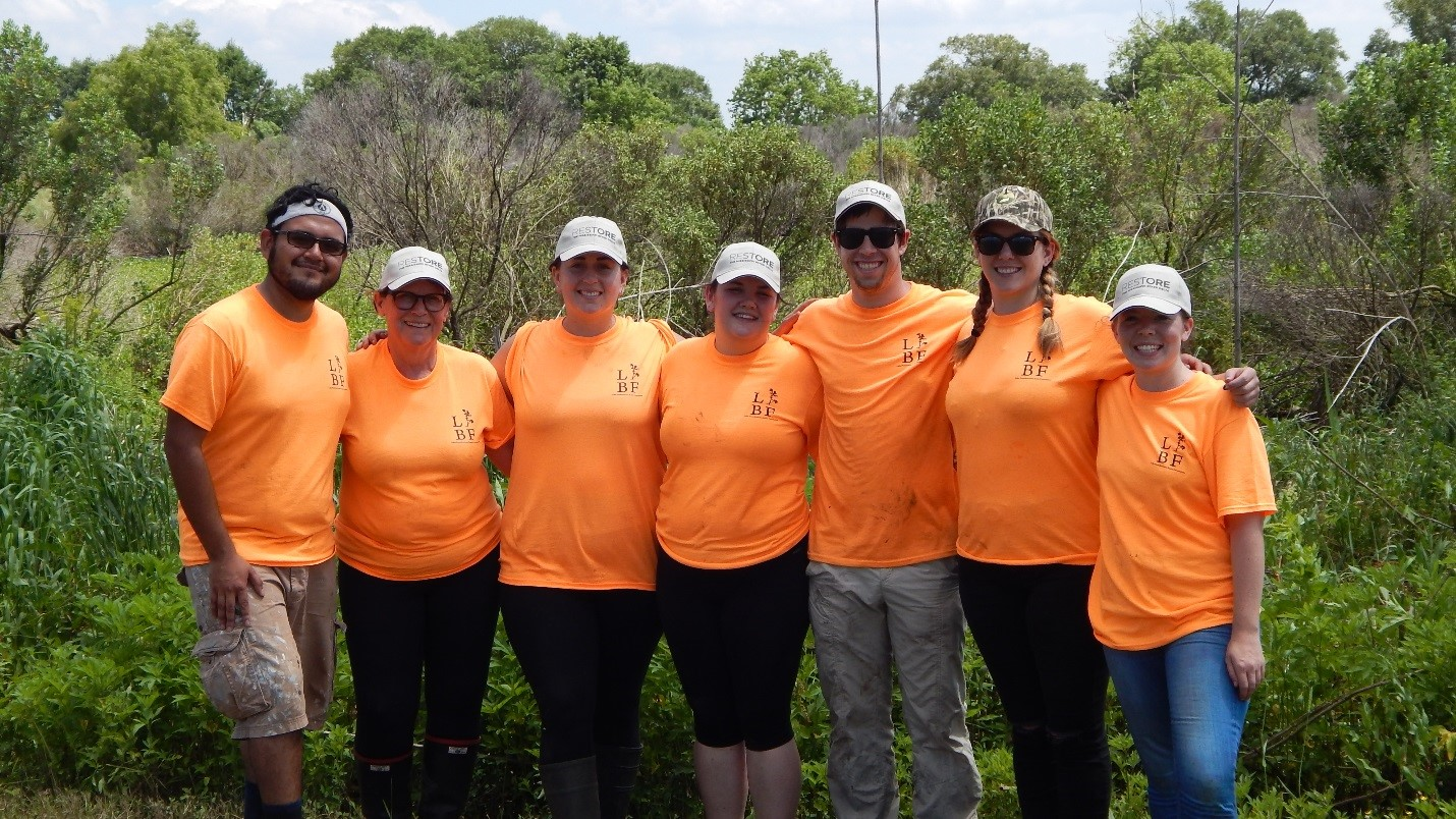 MRD staff members and volunteers planting trees in St. Bernard Parish. Exhausted and dirty, we planted 250 trees!