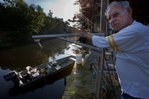 Older gentleman on dock - Restore the Mississippi River Delta
