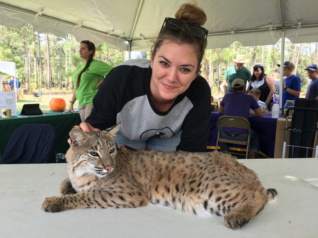 Sam the bobcat hanging out with Sam Carter the Outreach Coordinator.