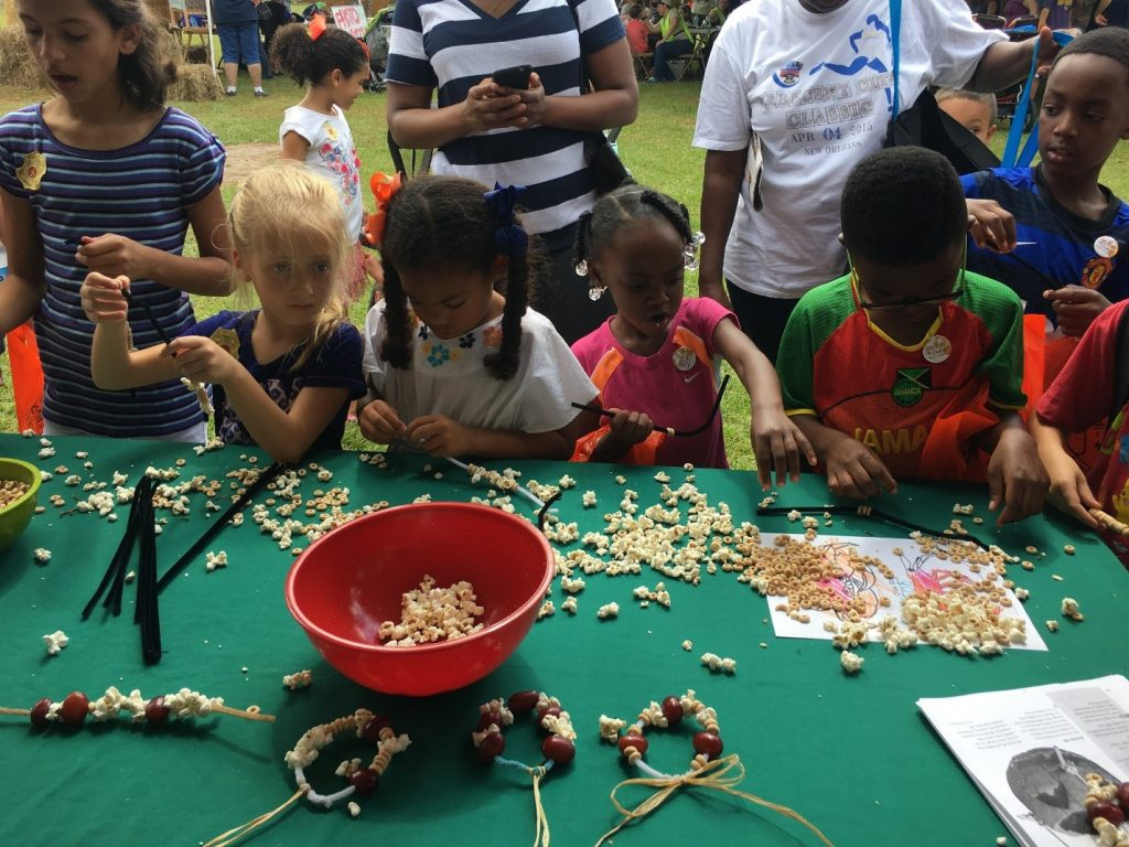 Kids busy stringing bird snacks and making ornaments to decorate their back yard trees. There were many great debates about whether birds or squirrels would feast on their creations.