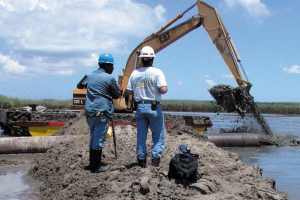 People working with soil in Louisiana